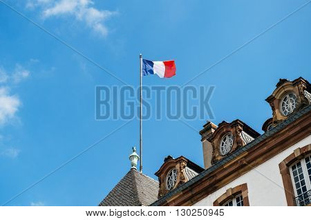 French flag above old City Hall in France