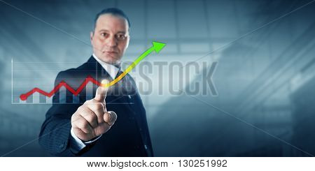 Positive looking entrepreneur is reaching forward to touch a growth trend line in a virtual bar chart. Line culminates in a green arrow tip. Business metaphor for economic boom and corporate growth.