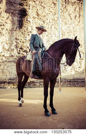 Cordoba Spain-March 11 2015: People mounted on horse on fair of Cordoba
