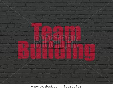 Business concept: Painted red text Team Building on Black Brick wall background
