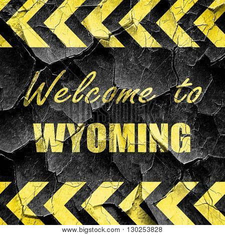Welcome to wyoming, black and yellow rough hazard stripes
