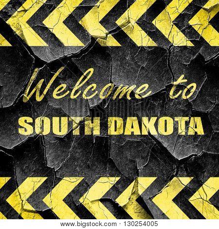 Welcome to south dakota, black and yellow rough hazard stripes