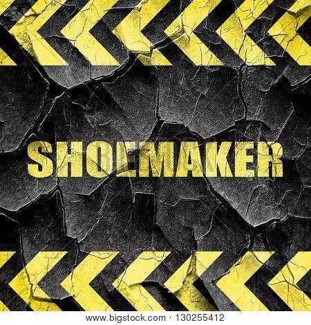 shoemaker, black and yellow rough hazard stripes