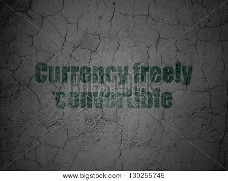 Currency concept: Green Currency freely Convertible on grunge textured concrete wall background