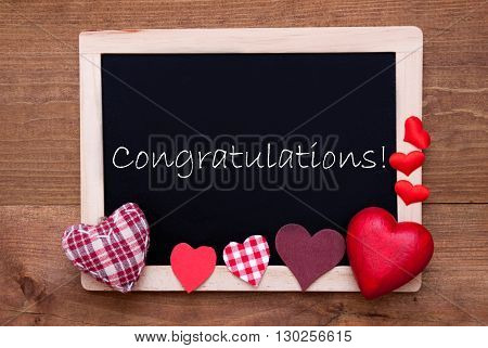 Blackboard With English Text Congratulations. Red Textile Hearts. Wooden Background With Vintage, Rustic Or Retro Style.