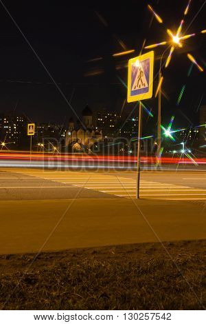 pedestrian crossing over the highway in summer evening
