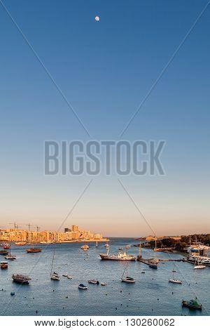 Sunset view of Marsamxett harbour. Malta island.