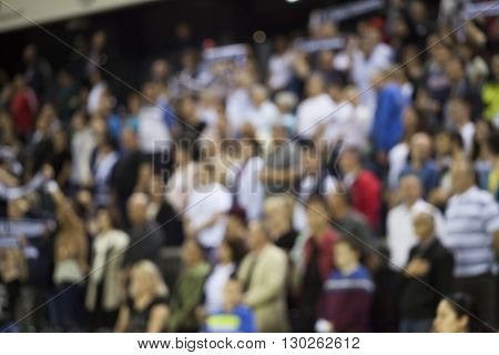 Defocused background of crowd of people at the basketball game
