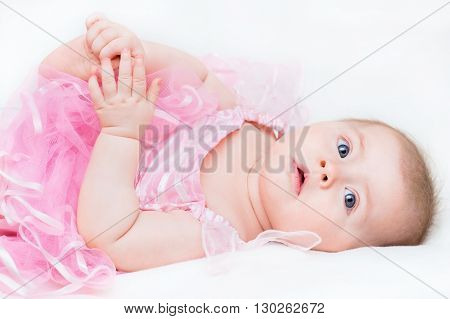 Cute baby girl wearing a pink dress