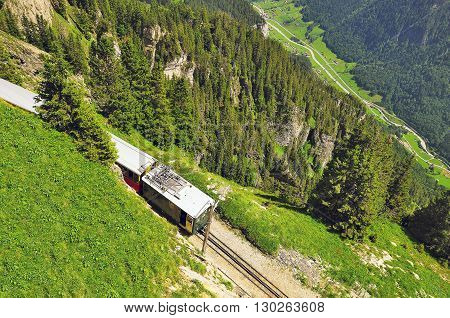 Retro passenger train moves from Schynige Platte to Interlaken. Switzerland.