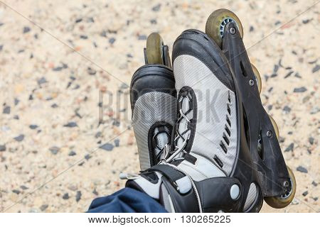 Closeup of roller skates blades outdoor. Sport equipment.
