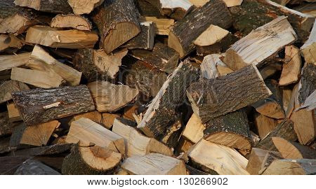 Winter is coming. Stack of chopped oak firewoods texture background
