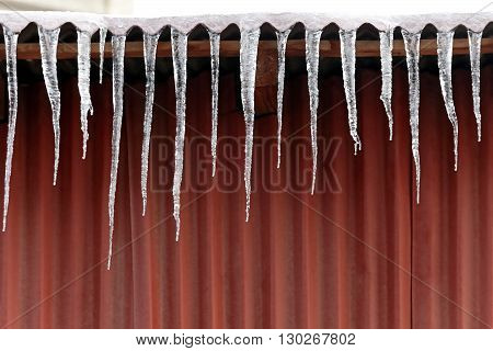 Danger Icicle Frozen Spikes of ice Formed at House