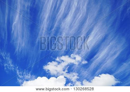 bright blue sky with striking clouds in summer