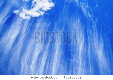 white striking clouds with bright blue sky