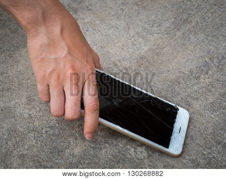 Hand Picking Broken Smart Phone of the Ground