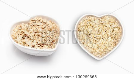 Oat in a heart shaped bowl, isolated on white