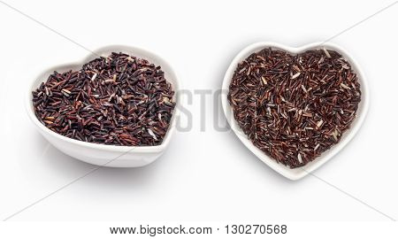 black pepper  in a heart shaped bowl, isolated on white