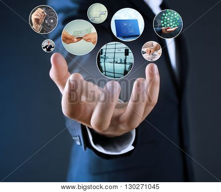 Man with preview digital business photos on virtual screen, concept of modern technology