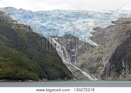 The Spanish Glacier and a Waterfall in Glacier Alley of Tierra del Fuego in Chile