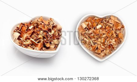 dried lemongrass   in a heart shaped bowl, isolated on white