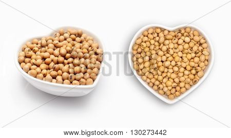 Soybean in a heart shaped bowl, isolated on white