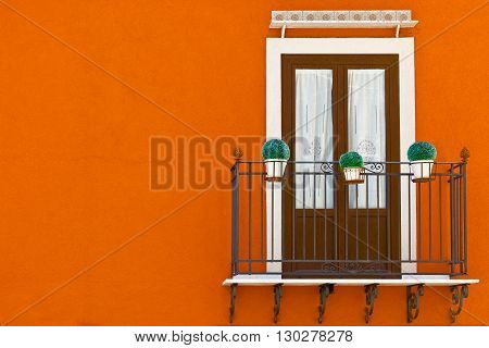 Italian Balcony in Palermo with Glass Shutters Decorated with Plants