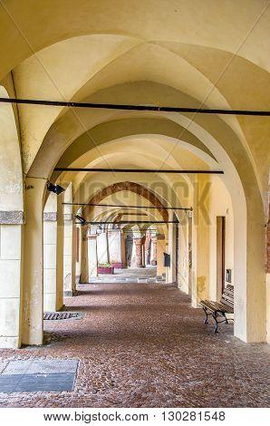 Avigliana turin portico yellow arches archway architecture
