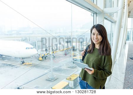Woman holding tablet pc in airport