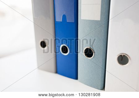 business, document, paperwork, office supply and education concept - close up of ring binders on table