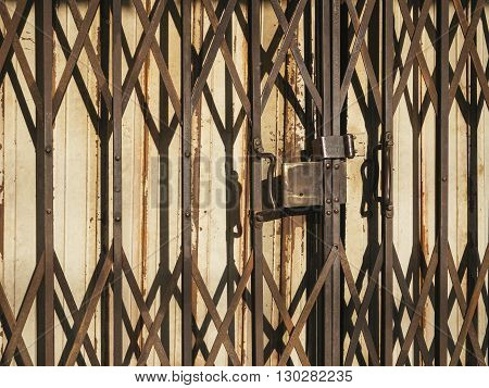 Old Rusty Textured Metal Door Shutter Cross Pattern Close