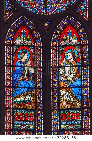 PARIS, FRANCE - MAY 31, 2015 Jesus Christ Mary Stained Glass Notre Dame Cathedral Paris France. Notre Dame was built between 1163 and 1250AD.