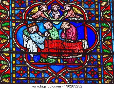 PARIS, FRANCE - MAY 31, 2015 King Death Bed Angels Medieval Stories Stained Glass Notre Dame Cathedral Paris France. Notre Dame was built between 1163 and 1250AD.