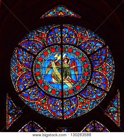 PARIS, FRANCE - MAY 31, 2015 Angel Stained Glass Notre Dame Cathedral Paris France. Notre Dame was built between 1163 and 1250AD.