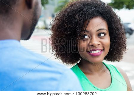 African american woman flirting with husband outdoor in the city