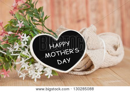 Happy mothers day text on wooden heart