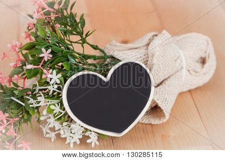 bouquet of flowers with wooden heart shape