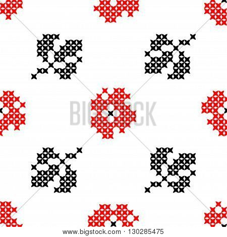 Seamless isolated texture with abstract red embroidered carnations with leaves for cloth. Embroidery. Cross stitch.