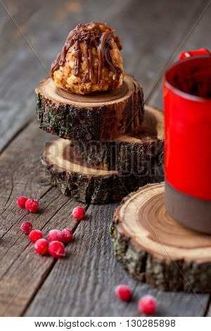 sweet little pastry with redcurrants and a mug on rustic wooden background