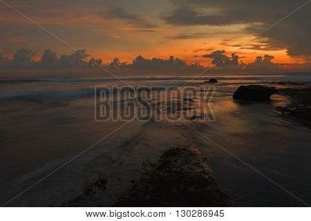 Sunset at Tanah Lot Temple Bali Indonesia.