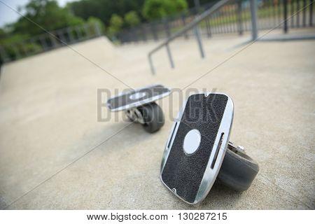 closeup of freeline skateboard on skatepark ramp