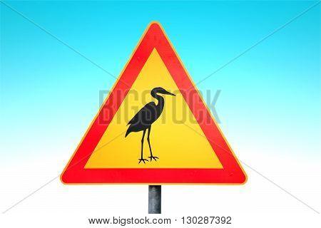 Attention of storks traffic sign against blue sky background.