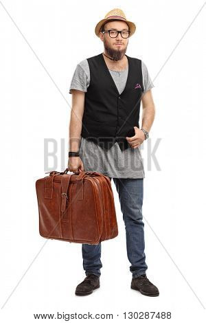 Full length portrait of a young hipster holding a brown briefcase isolated on white background