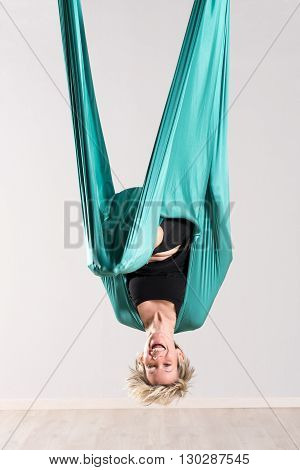 Laughing Upside Down Woman Doing Aerial Yoga