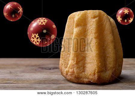 pandoro cake on wood with christmas balls