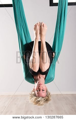 Woman Hanging Upside Down In Aerial Yoga Tarp