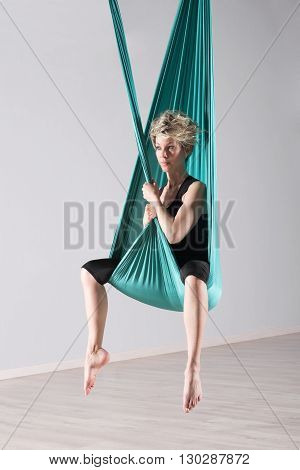 Woman Sitting In Aerial Yoga Blanket