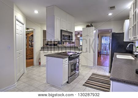 Open concept white kitchen with island