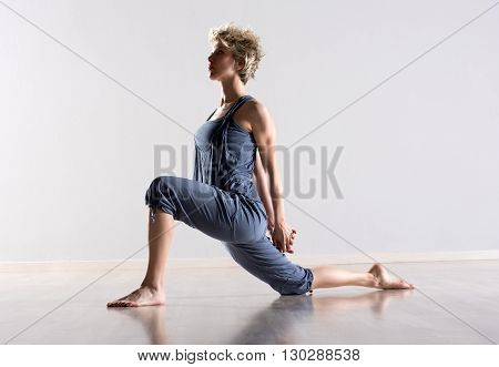 Woman Stretching Legs And Shoulder Muscles
