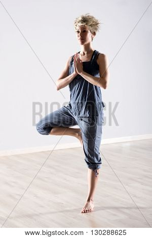 Woman Balanced On One Leg In Yoga Position